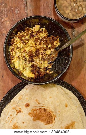 Mexican Breakfast, Machaca From Sonora With Eggs, Beans And Flour Tortillas. For Restaurant, Food Bl