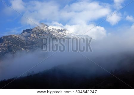 close up fogy mountains and forest over sunny and cloudy morning sky in Kayseri, Turkey