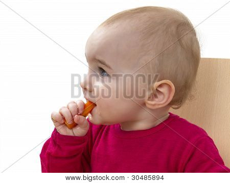 Child In Red Shirt Eating