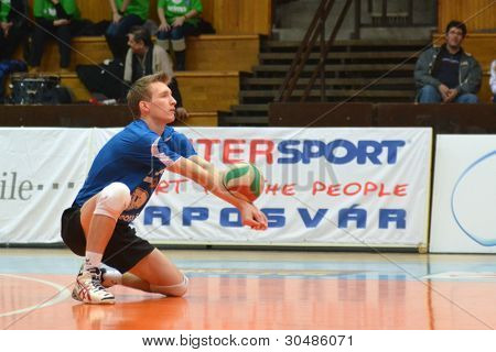 KAPOSVAR, HUNGARY - FEBRUARY 23: Bence Bozoki in action at a Hungarian volleyball National Championship game Kaposvar (blue) vs. Csepel (deep blue), on February 23, 2012 in Kaposvar, Hungary.