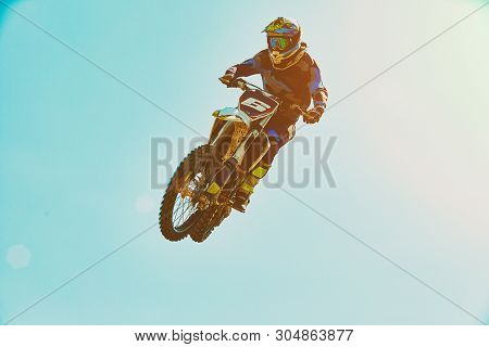 Extreme Sports, Motorcycle Jumping. Motorcyclist Makes An Extreme Jump Against The Sky. Extreme Spor
