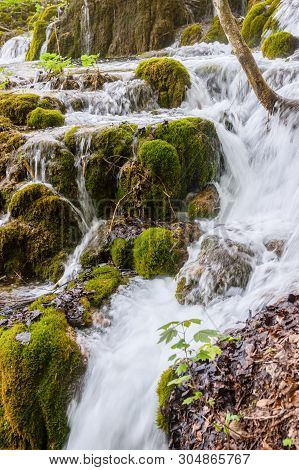 Beautiful Nature With Water Falling Down The Slope Over The Mossy Rocks In Plitvicka Lakes National