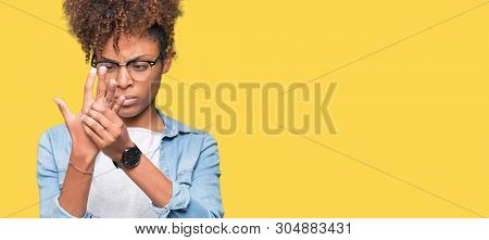 Beautiful young african american woman wearing glasses over isolated background Suffering pain on hands and fingers, arthritis inflammation