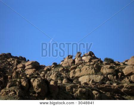 Shot Of Rocks On Cliff Against Blue Sky
