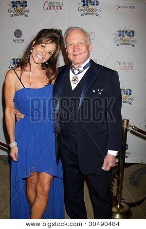 LOS ANGELES - FEB 26:  Michelle Sucillon; Buzz Aldrin arrive at the