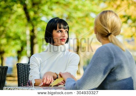 Friendship meeting. Friendship or rivalry. Girls friends drink coffee talk. Conversation of two women cafe terrace. Friendship friendly close relations. Revelation and support. Trustful communication poster