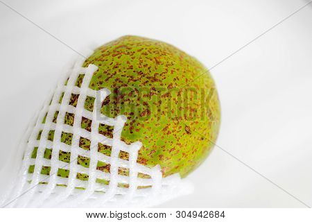Avocado Fruit With Foam Epe Net On Isolated White Background. Abstract Of Healthy, Wellness And Vita