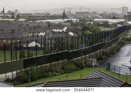 Belfast, Northern Ireland  - August 1: Wall Dividing Catholic Belfast From Protestant Neighborhood.
