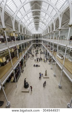 Edinburgh, Scotland  - August 7: Visitors View Exhibits On Multiple Levels Of The Grand Gallery Of T