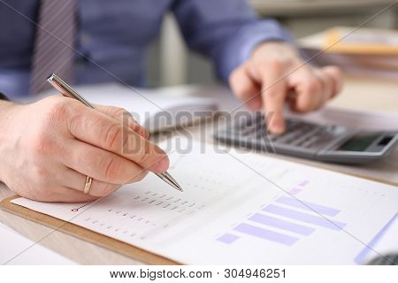 Accountant Calculate Finance Company Expenses. Man Accounting Financial Data Using Calculator, Graph