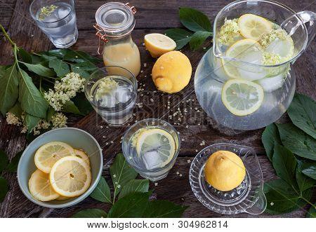 Homemade Lemonade Made With Elderflower Sirup And Slices Of Lemon
