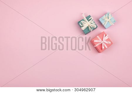 Mother Day, Festive, Birthday, Gift Pastel Minimal Background. Multicolored Gift Boxes On Pink Backg