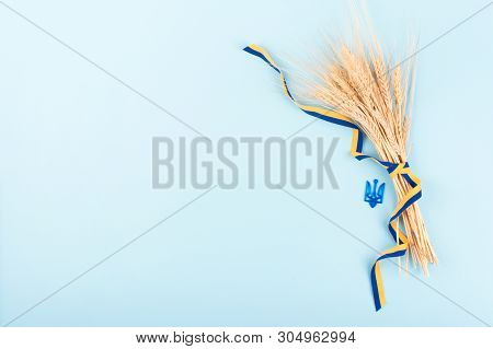 Ukrainian Background With National Symbols, Coat Of Arms Trident, Yellow And Blue Ribbon, Golden Whe