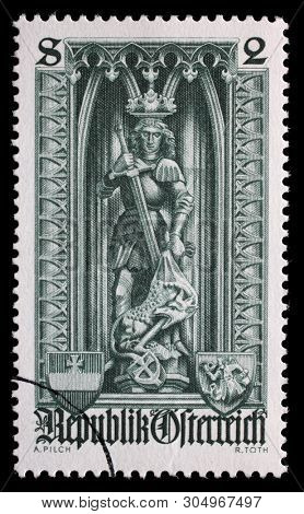 AUSTRIA - CIRCA 1969: A stamp printed in the Austria dedicated to 500th anniversary of Diocese of Vienna, shows the statue of St. George and the Dragon in St. Stephens Cathedral, Vienna, circa 1969