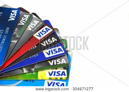 Phuket, Thailand -  April 17, 2019 : Close Up Stack Of Visa Credit And Debit Cards On White Color Ba