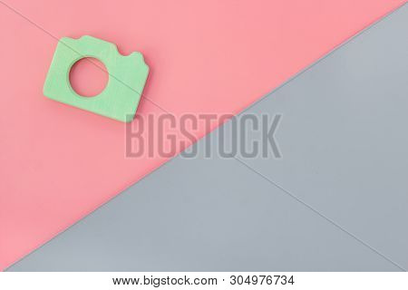Photo Camera Concept On Pink And Gray Background Top View Copy Space