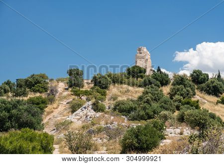 Monument Of Filopappos Above The Trail On The Summit Of Filopappou Hill