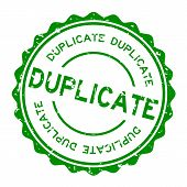 Grunge green duplicate word round rubber seal stamp on white background poster