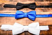 Esthete detail. Fix bow tie. Groom wedding. Textile fabric bow close up. Modern formal style. Menswear clothes. Perfect outfit. Tying bow tie. Wedding accessories. Fashion accessory poster