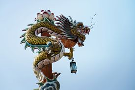 Chinese Dragon In Front Of Blue Sky Photo