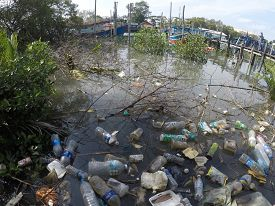 MERSING, MALAYSIA - 3 JUNE 2019: Plastic pollution environmental problem. Plastic garbage is washed into rivers and ends up in ocean.