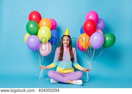 Portrait Of Charming Cheery Girl Holding Helium Balls Sitting Lotus Position Crossed Legs Isolated B