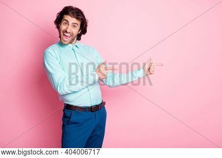 Photo Of Young Attractive Man Happy Excited Positive Show Point Fingers Empty Space Advert Promo Iso