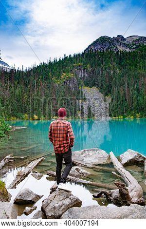 Majestic Mountain Lake In Canada. Upper Joffre Lake Trail View, Men Visit Joffre Lakes Provincial Pa