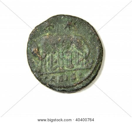 Ancient Roman coin on a white background. Capitoline wolf with Romulus and Remus. Back
