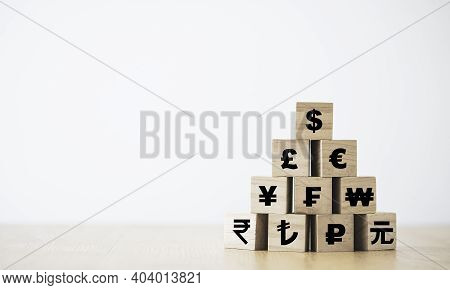 Us Dollar Print Screen On Wooden Cube On The Top Of  Renminbi Yuan  Yen Euro And Pound Sterling Sign
