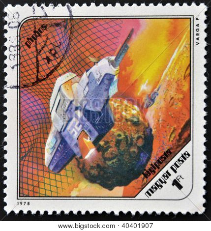 A stamp printed in Hungary shows a futuristic space ship around Phobos the Martian moon