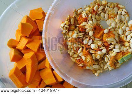 Fresh Orange-colored Pumpkin And Seeds, Pumpkin Suitable For Making Dessert.