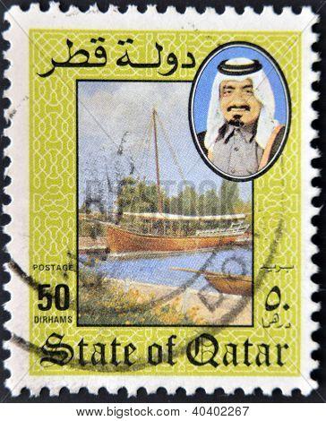 A stamp printed in Qatar shows a portrait of Sheikh Khalifa bin Hamed Al-Thani, landscape with boat