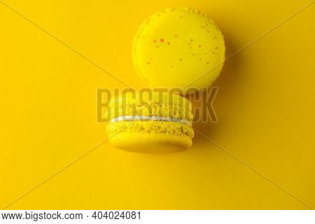 Yellow Macaroons On A Yellow Background. Yellow Sweets. Yellow Background. Macaroons Close-up. Top V