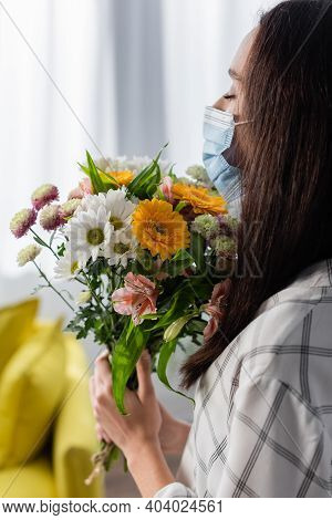 Allergic Woman In Medical Mask Holding Flowers With Closed Eyes