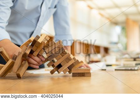 Hand Of Pulling Out Wood Block Fail On Building Tower. Fail Building Tower, Risk And Strategy Of Pro