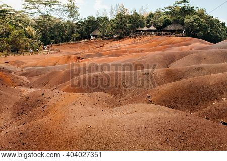 Seven Colored Earths In Mauritius, Nature Reserve, Chamarel. The Green Forest Is Behind Us.mauritius