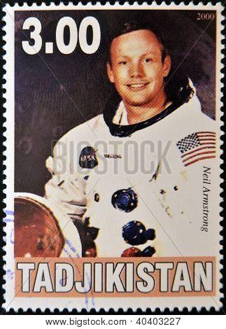 TAJIKISTAN - CIRCA 2000: A stamp printed in Tajikistan shows Neil Armstrong circa 2000