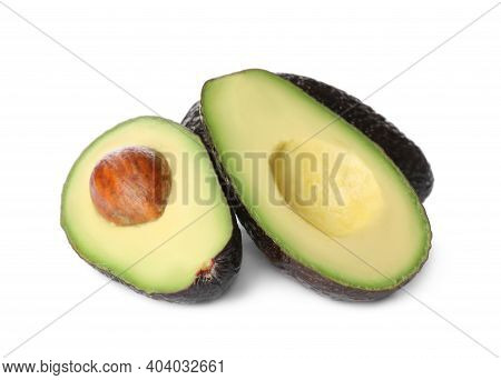 Cut And Whole Ripe Avocadoes On White Background