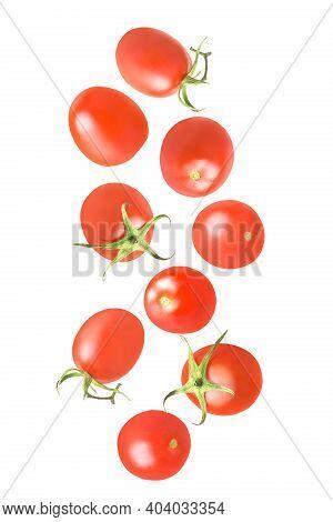Set Of Flying Fresh Whole Tomatoes Isolated On White Background
