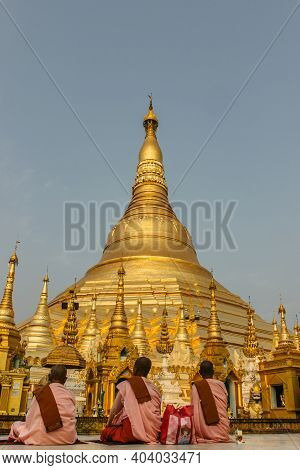 Morning Meditation In The Shwedagon Pagoda,the Golden Pagoda In Yangon. It Is The Most Sacred Buddhi