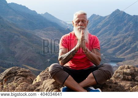 Senior Athlete Man Greeting Sunrise And Meditating, Mindful Living And Healthy Wellbeing Concept