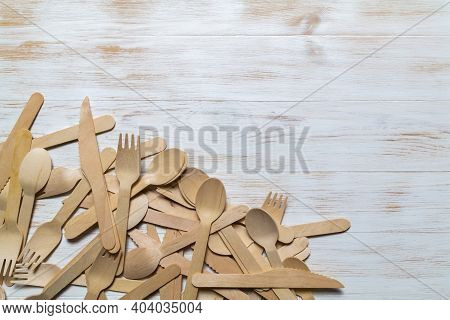 Wooden Cutlery On Wood Background. Disposable Cutlery, Tableware. Environmental Protection, Save Nat