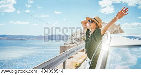 Cheerful Woman Portrait Enjoying The Seaside Road Trip. Dressed A Black Dress With Straw Hat And Sun