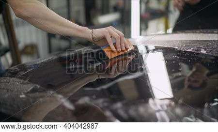 Detailing The Car. The Master Sticks A Protective Film On The Soot Of The Car. Car Detail Series Con