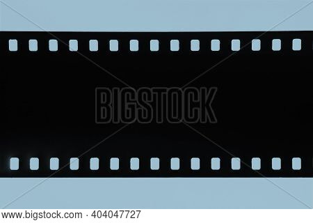 Strip Of Old Celluloid Film, Old Photographic Film, Negative On Blue Background