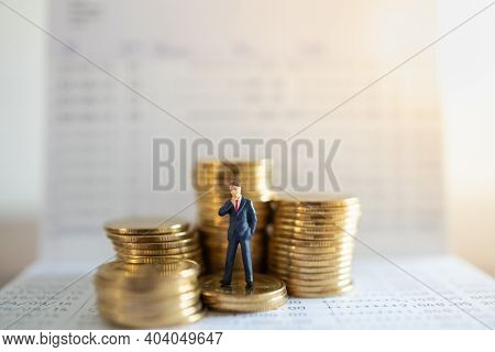 Business, Money Investment And Planning Concept.businessman Miniature Figure People Figure Standing
