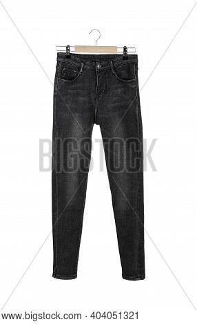 Dark Grey Female Warm Winter Jeans On A Hanger Isolated On White Background.