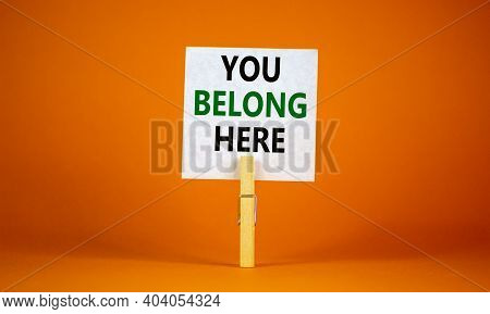 You Belong Here Symbol. Wooden Clothespin With White Paper. Words 'you Belong Here'. Beautiful Orang