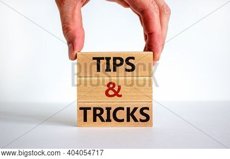 Tips And Tricks Symbol. Wooden Blocks With Words 'tips And Tricks'. Beautiful White Background. Busi